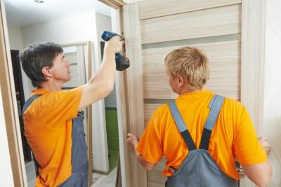 door installation workers