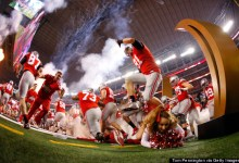 Photo of Ohio State Cheerleader Nearly Steamrolled By Football Team During Entrance Fail
