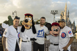 World champions (L-R) Javier Baez, MVP Ben Zobrist and Addison Russell, of the Chicago Cubs, pose for a celebratory photo with Goofy and Mickey Mouse Saturday, Nov. 5, 2016, at Magic Kingdom Park in Lake Buena Vista, Fla. The players were honored among thousands of fans in a parade at Walt Disney World celebrating the team's historic victory. (Preston Mack, photographer)