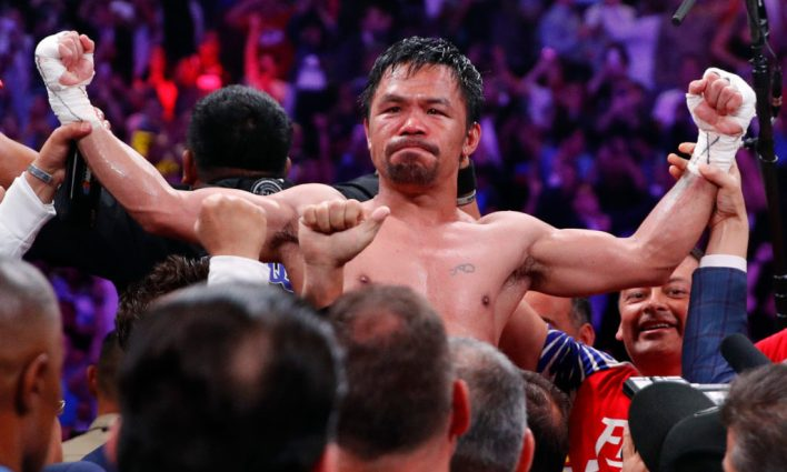 Manny Pacquiao puts Keith Thurman on his back in the 1st. Goes on to win in split decision