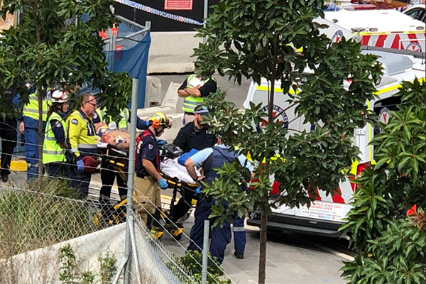 Workers trapped in Sydney scaffolding collapse