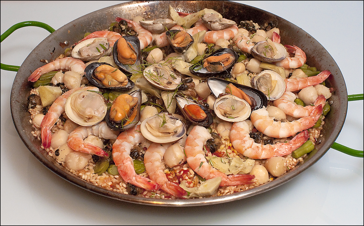 Paella with seafood and snails
