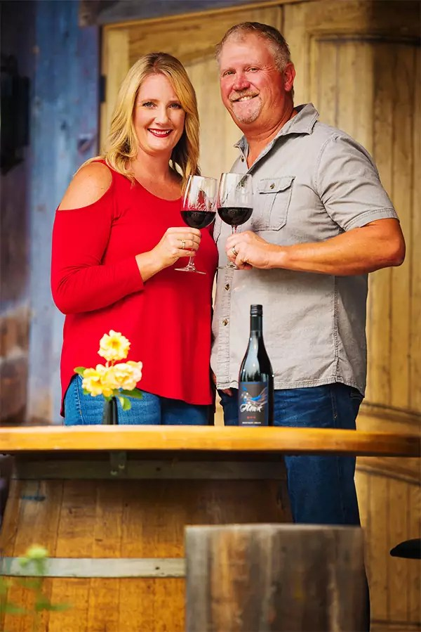 2Hawk Vineyard and Winery Owners Jen and Ross Allen with 911 Red Blend Wine