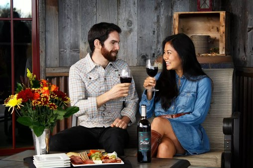 Couple Toasting Outside 2Hawk Vineyard and Winery Tasting Room