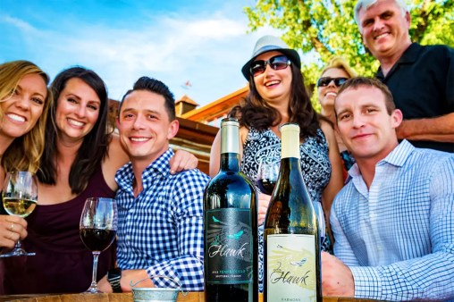 Friends Wine-Tasting Outdoors at 2Hawk Vineyard and Winery