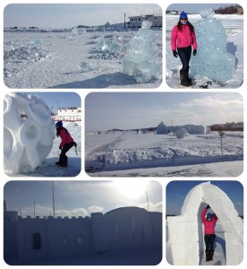 Laura on the frozen lake in Yellowknife with snow castle & ice sculptures