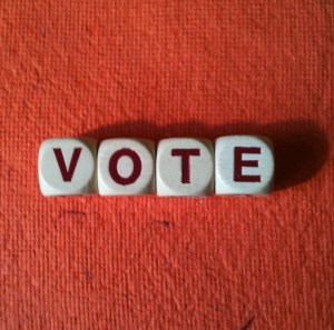 Vote spelled out on a red background