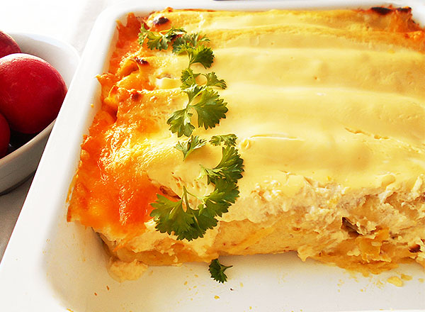 Rotisserie Chicken Guacamole Enchiladas with Sour Cream: easy to make, loaded with rotisserie chicken and sour cream.