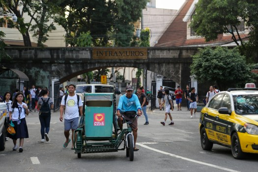 A tricycle leaves the walled city of Intramuros