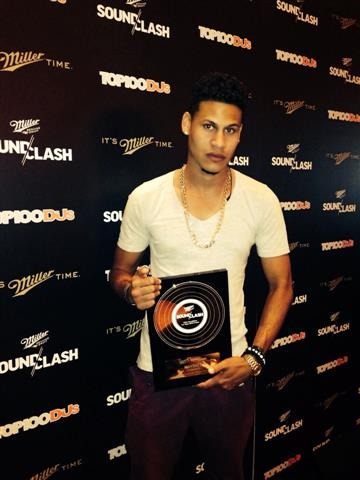 Raydizz holds his trophy after his success at MIller Soundclash in Las vegas