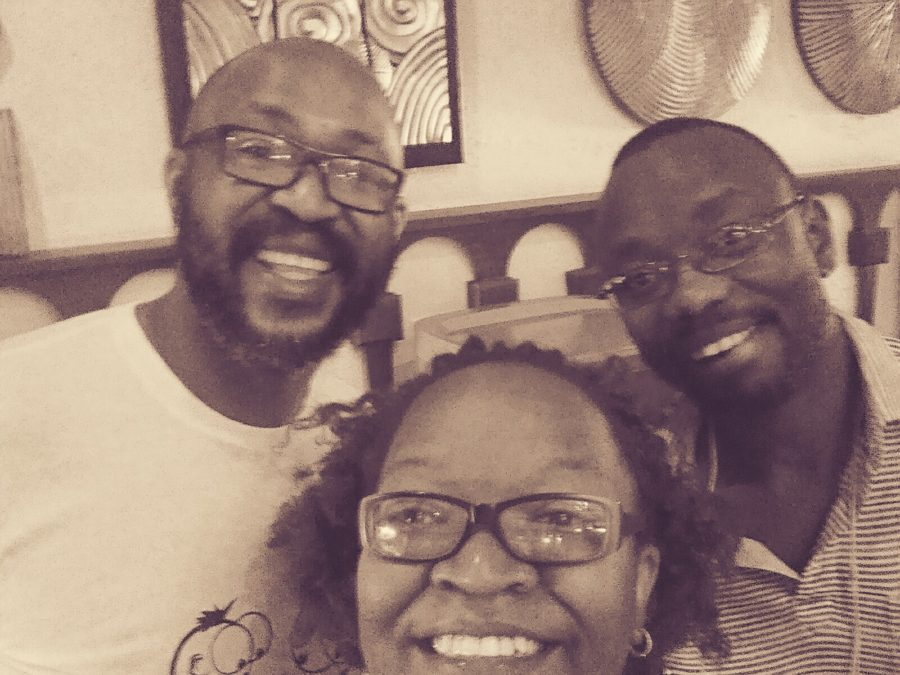 Carl Joshua Ncube and wife Nelsy with logistics expert Archie Mhone