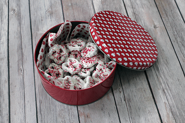 white chocolate covered pretzels in valentine tin