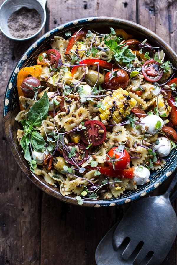 Pasta salad with pesto, cheese, corn, tomatoes and peppers