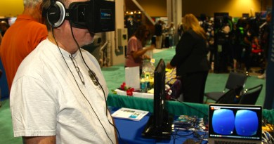 Booth visitor experiencing virtual diving with the Oculus Rift