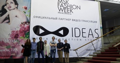 The IDEAS Studio team poses at the entrance of Minsk Fashion Week in Belarus.