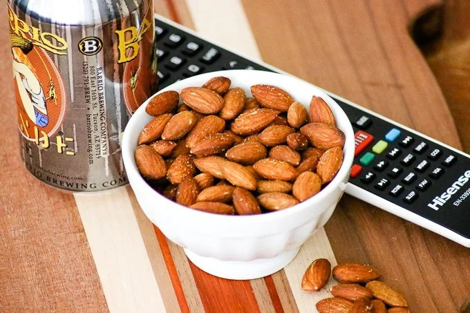 Top view of a bowl of Baked Spiced Almonds.