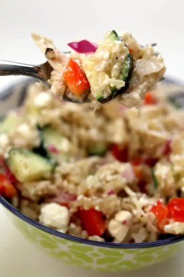Instant Pot Greek Chicken Rice Bowls--brown rice and chicken are tossed with a lemon juice, olive oil, fresh garlic and vinegar dressing. Diced cucumber, red bell pepper, red onion and feta cheese are stirred into the rice to complete the one pot meal.