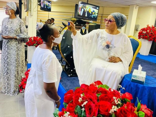 Billionaire businesswoman Folorunso Alakija pictured anointing her church members with olive oil 1