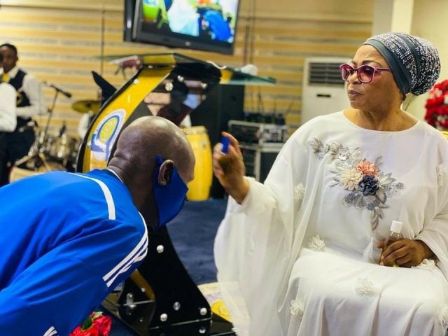 Billionaire businesswoman Folorunso Alakija pictured anointing her church members with olive oil 3