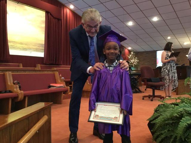 Pastor John Major with Graduate