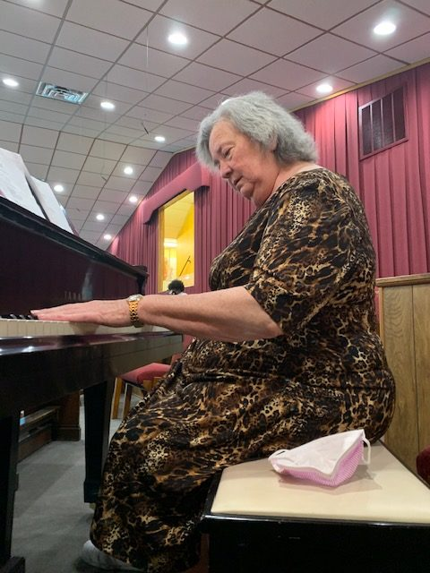 Woman playing piano at church