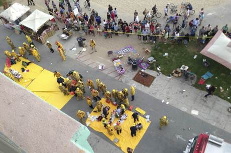 Handout of injured pedestrians attended to after a car crashes into pedestrians on the boardwalk in Venice Beach