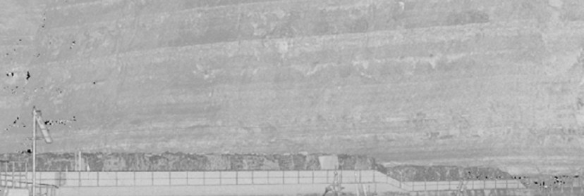"Enlargement of an area at the right hand side, showing the even ""reflectance"" across the cliff face and harbor wall."