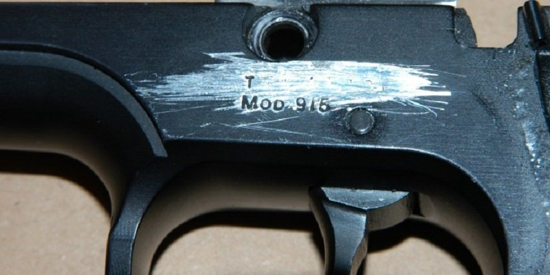 A rifle, with its serial number scratched off.