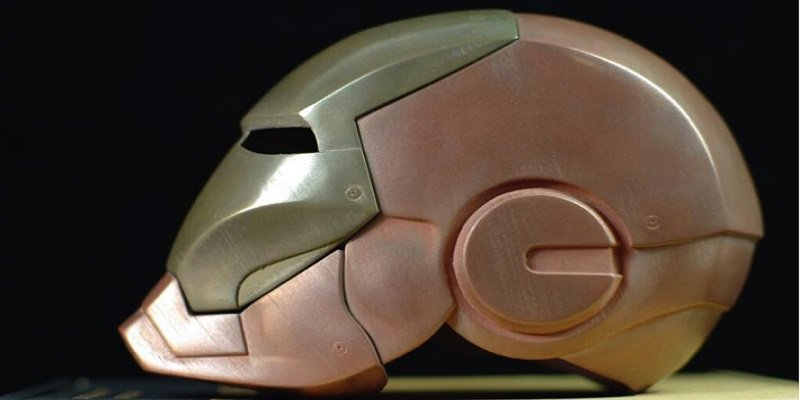 A 3D printed Ironman helmet, made of bronze and copper metal filaments.