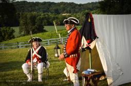 """Commander Tom Hankins (R) is wearing an authentic replica of a British """"redcoat."""" This coat was used in the movie The Patriot."""