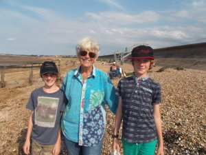 Sheila with her great nephews at the caravan beach