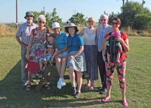 Irené - in the white hat - surrounded by family. Four generations in this photo!