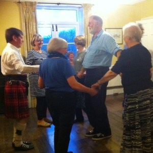 Ken-the-kilt and Anne lead a reel