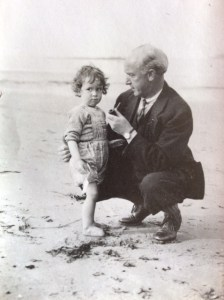 My grandfather (appropriately dressed???) with my father on the beach