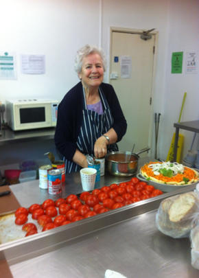 Paula cooking in the Catching Lives kitchen