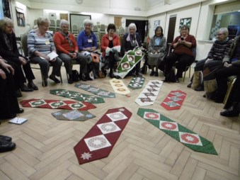 U3A Patchwork and Quilting Class showing off their handiwork