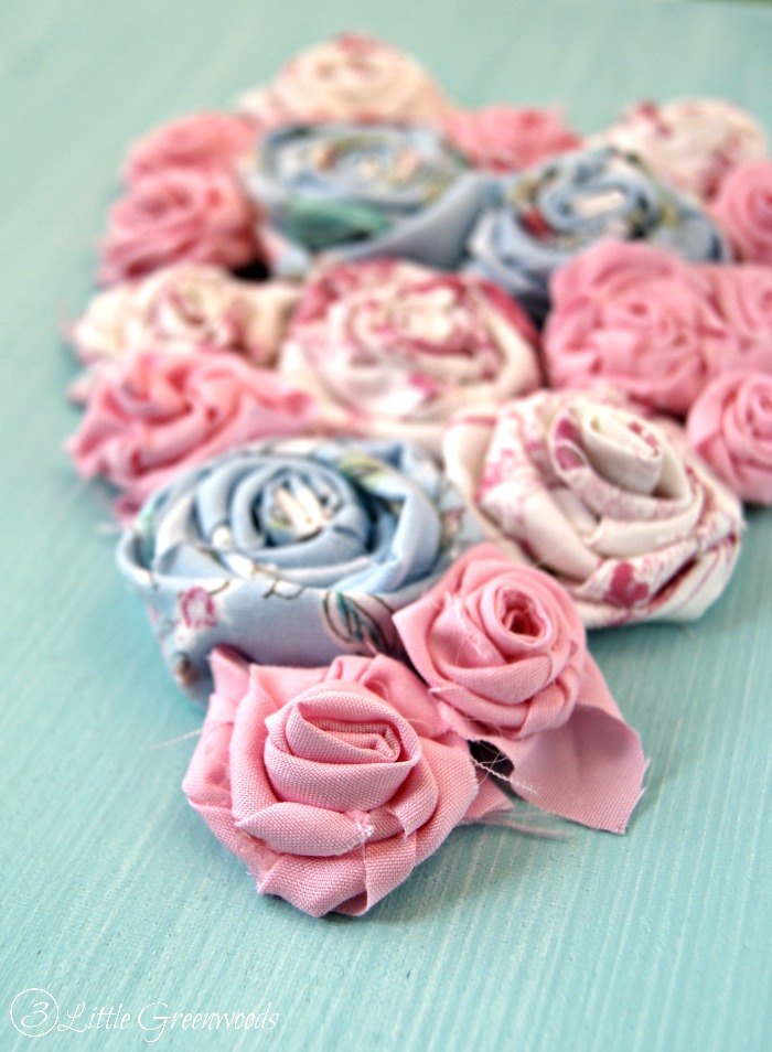 Rolled Fabric Flowers Art for Valentine s Day Bust your scrap fabric stash with this Adorable Rolled Fabric Flowers  Artwork for Valentine s Day