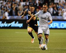 Galaxy forward Robbie Keane chases Whitecaps midfielder Russell Tiebert at BC Place on April 4, 2015.  Courtesy of Anne-Marie Sorvin of USA Today Sports.