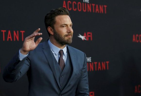 Ben Affleck waves to fans outside the TCL Chinese Theatre on October 10, 2016 before the premiere of his latest film, The Accountant. Photo by Mario Anzuoni.