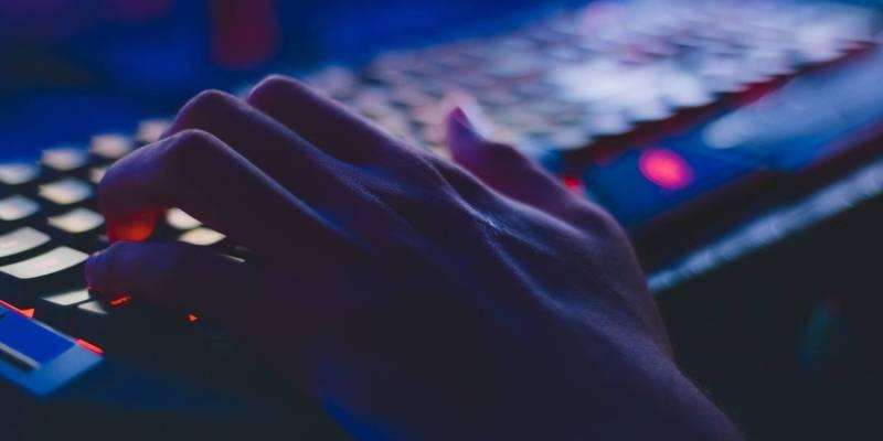 hacker using keyboard