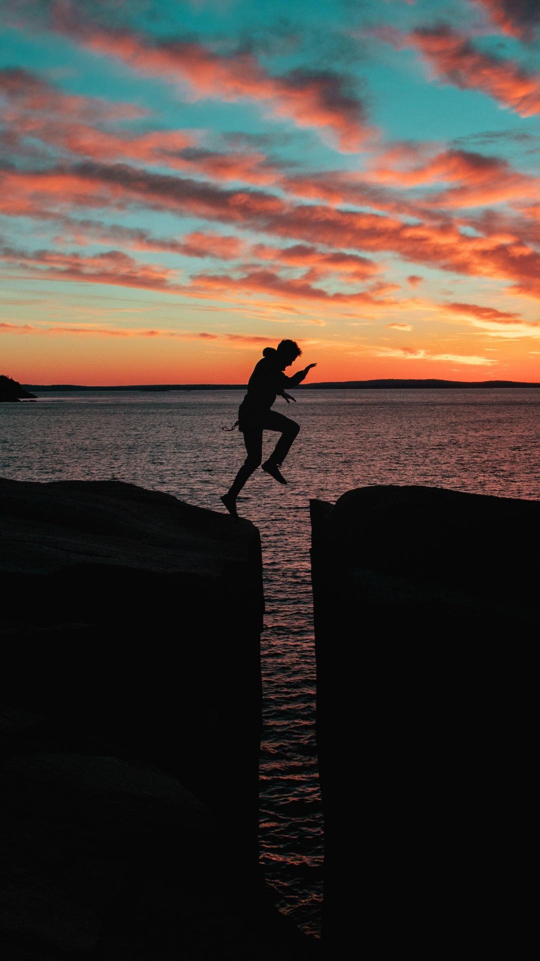 silhouette man jump sea 116659 1080x1920 Silhouette