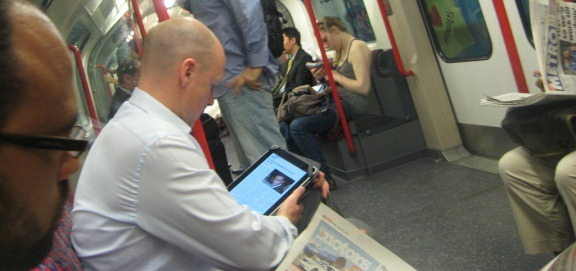 ipad as a content consumption device on a subway full