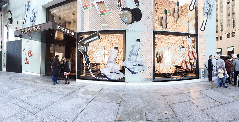 louis vuitton store signage in NYC glass windows