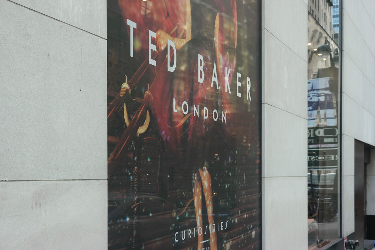 See-through signage windows storefront NYC 5th Ave. Ted Baker