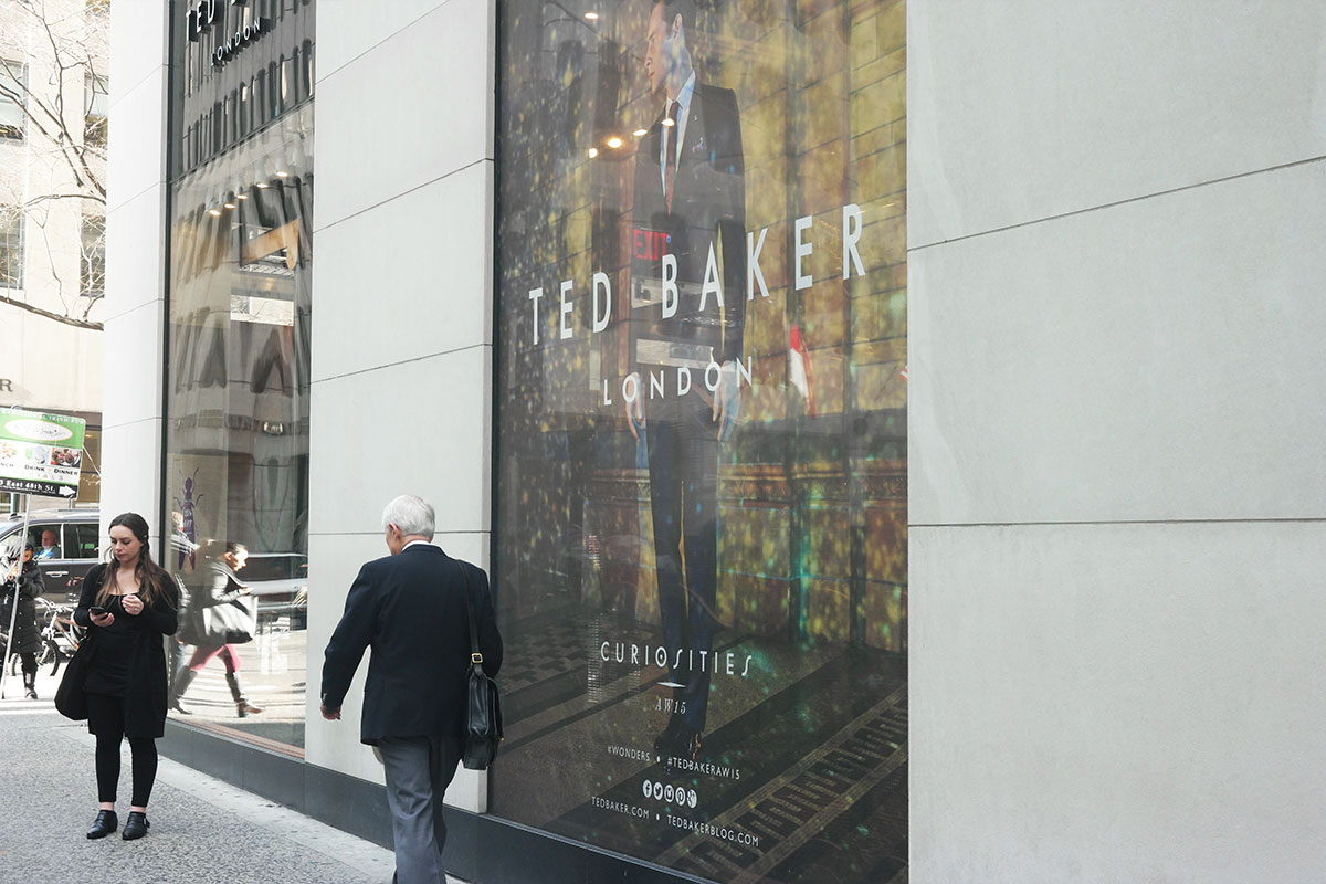 storefront windows signage printing perforated vinyl see-though NYC