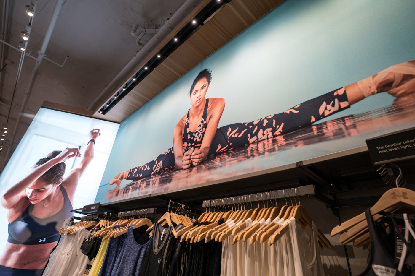 printed display sign signage fabric SEG printing tension stretch silicone edge graphics visuals merchandising marketing advertising in-store under armour