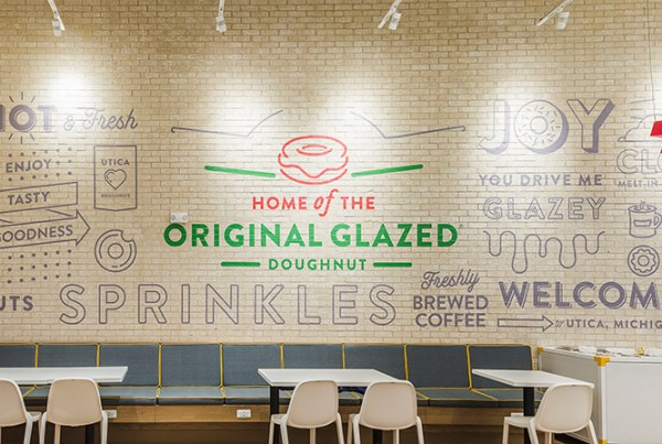 vinyl for textured surfaces rough wrap brick wall texture adhesive material installation outdoor paint painted brick wrap contour cut Krispy Kreme signage