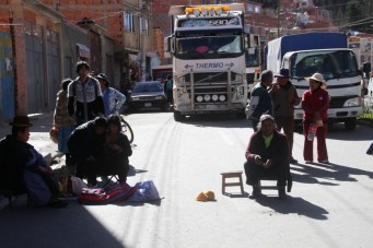 Protesters block the road.