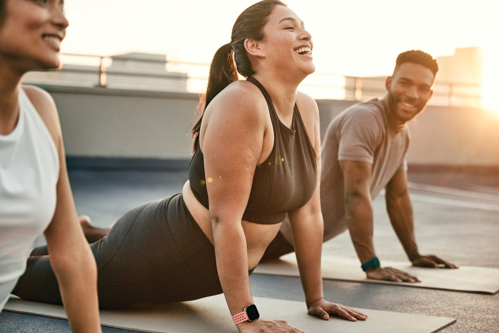 People doing Yoga with the FitBit