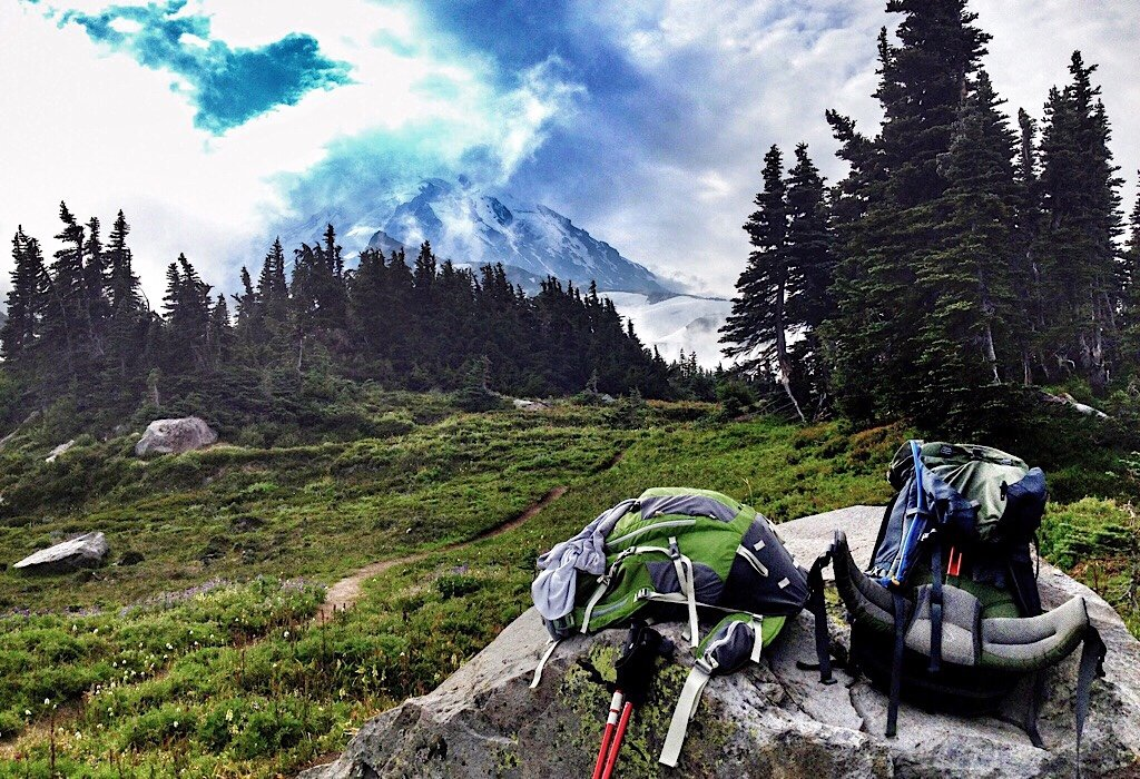 backpacks in the mountains, travel items